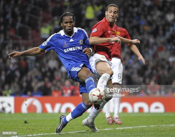 Chelsea's Didier Drogba and Manchester United's Rio Ferdinand battle for the ball