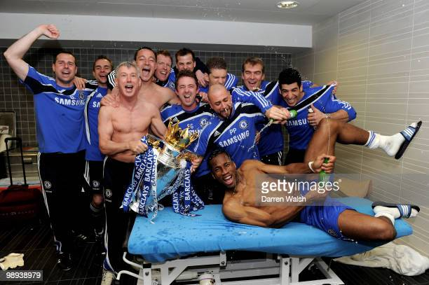 Chelsea's Didier Drogba and the chelsea back room staff celebrate with the trophy after winning the league with an 80 victory during the Barclays...