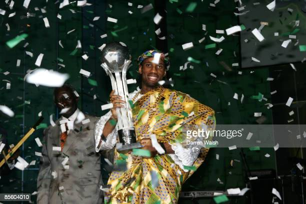 Chelsea's Didier Drogba celebrates being named African Player of the Year with the trophy