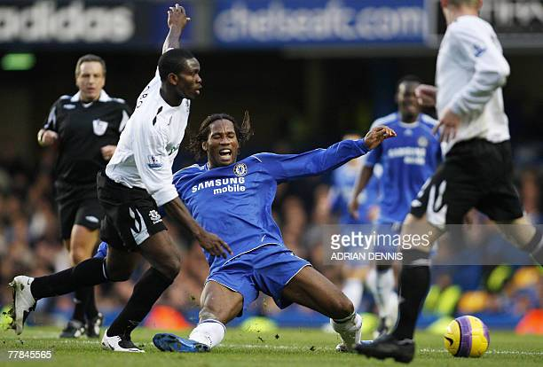 Chelsea's Didier Drogba competes for the ball against Everton's Joseph Yobo during their Premiership football match at Stamford Bridge in London 11...