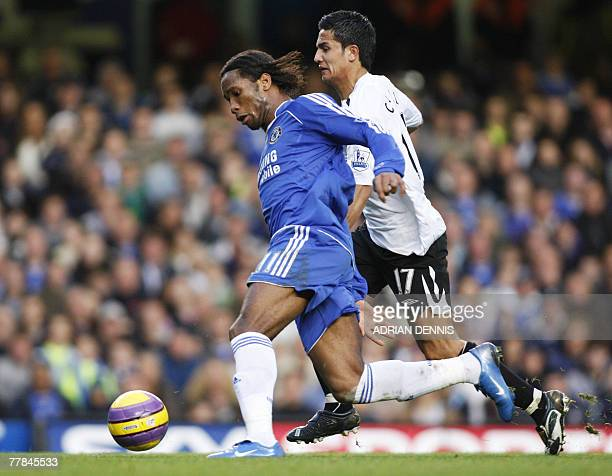 Chelsea's Didier Drogba competes for the ball against Everton's Tim Cahill during the Premiership football match at Stamford Bridge in London 11...