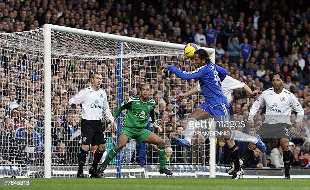 Chelsea's Didier Drogba heads the ball to score the opening goal against Everton during the Premiership football match at Stamford Bridge in London...