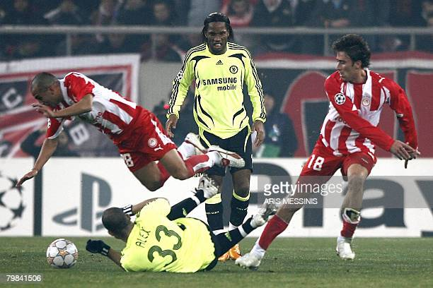 Chelsea's Didier Drogba looks on his as teammate Alex tackles Olympiakos' Cristian Ledesma during their first knock out round Champions League...