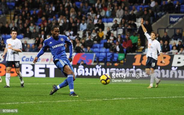 Chelsea's Didier Drogba scores his teams fourth goal of the match during the Barclays Premier League match between Bolton and Chelsea at the Reebok...