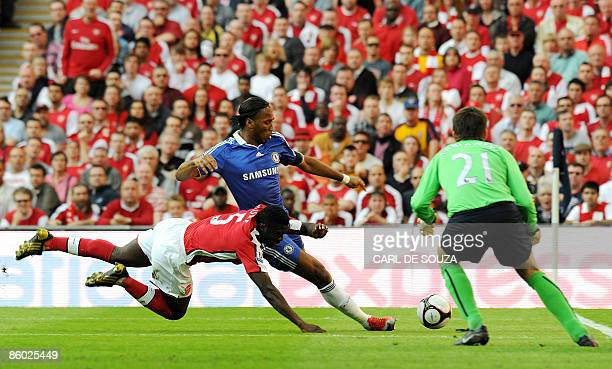 Chelsea's Didier Drogba tries an unsuccessful shot at goal as he vies with Arsenal's Ivorian defender Kolo Toure and Arsenal's Polish goalkeeper...