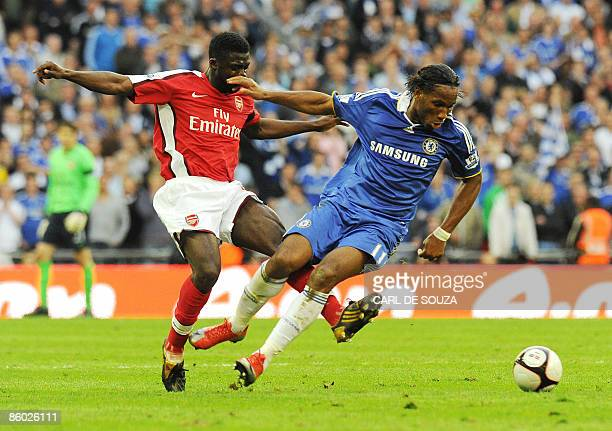 Chelsea's Didier Drogba vies with Arsenal's Ivorian defender Kolo Toure during the FA Cup SemiFinal football match at Wembley Stadium in London on...