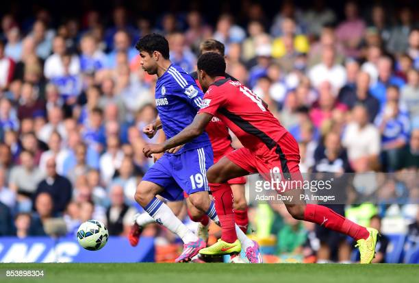 Chelsea's Diego Costa and Leicester City's Liam Moore battle for the ball during the Barclays Premier League match at Stamford Bridge London