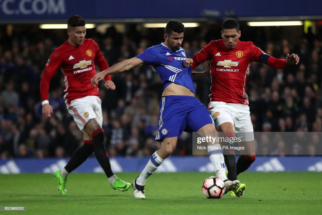 Chelsea's Diego Costa and Manchester United's Chris Smalling battle for the ball during the Emirates FA Cup, Quarter Final match at Stamford Bridge, London.