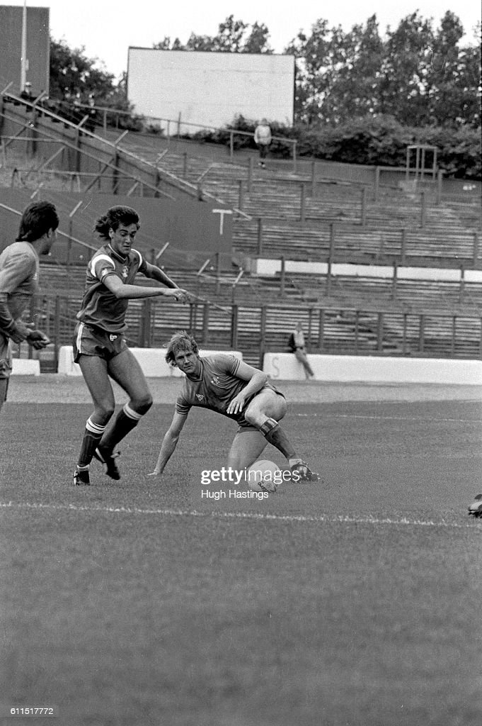 Chelsea's Doug Rougvie clears in front of the vacant north terrace ...