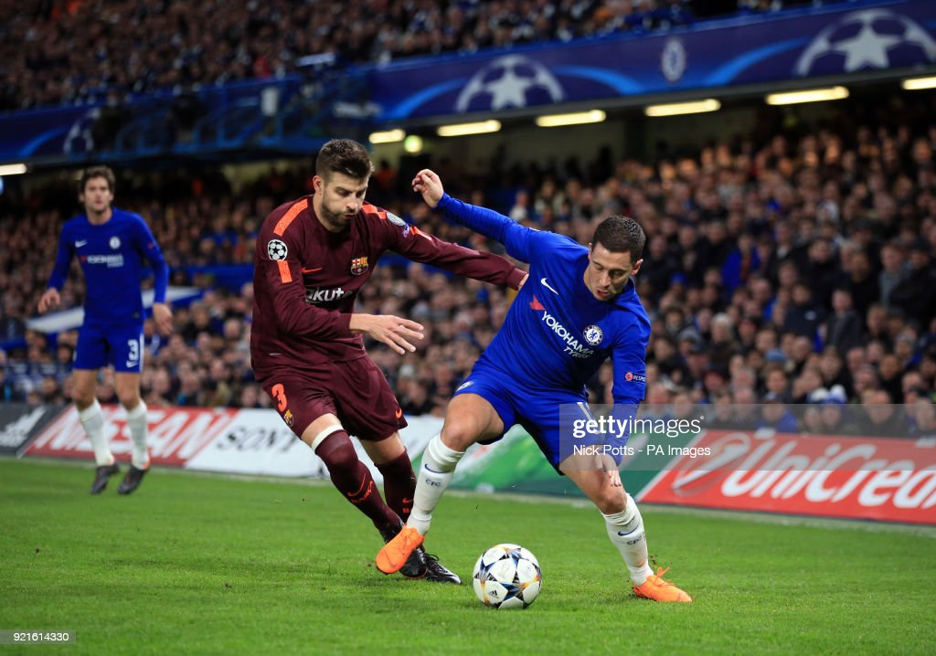 Chelsea's Eden Hazard (right) and Barcelona's Gerard Pique battle for the ball during the UEFA Champions League round of sixteen, first leg match at Stamford Bridge, London.