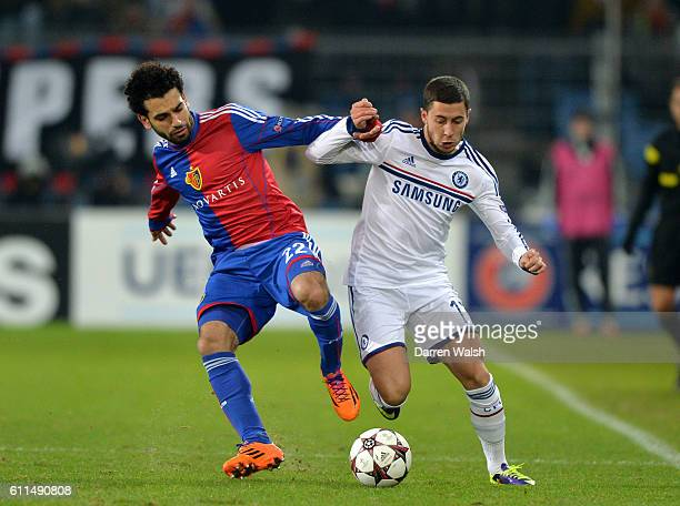 Chelsea's Eden Hazard and Basel's Mohamed Salah battle for the ball during a UEFA Champions League Group E match between FC Basel and Chelsea on 26th...