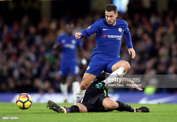 Chelsea's Eden Hazard and Brighton Hove Albion's Beram Kayal battle for the ball during the Premier League match at Stamford Bridge London