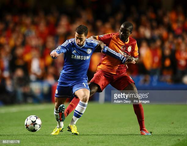 Chelsea's Eden Hazard and Galatasaray's Emmanuel Eboue battle for the ball