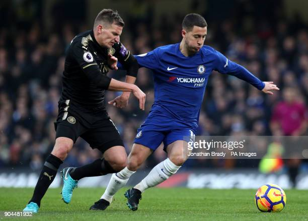 Chelsea's Eden Hazard and Leicester City's Marc Albrighton during the Premier League match at Stamford Bridge London
