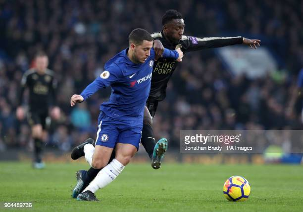 Chelsea's Eden Hazard and Leicester City's Wilfred Ndidi battle for the ball during the Premier League match at Stamford Bridge London