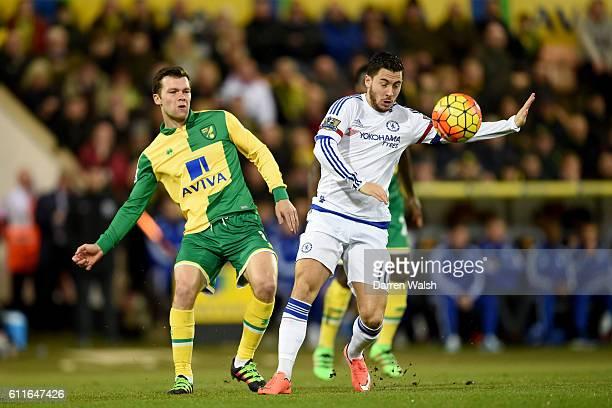 Chelsea's Eden Hazard and Norwich City's Jonny Howson battle for the ball
