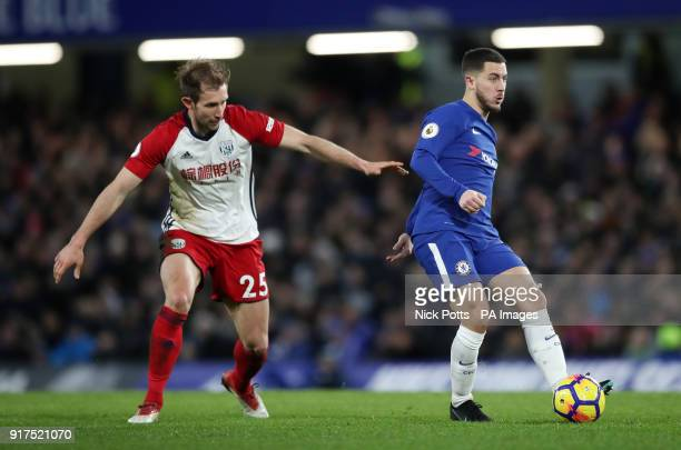 Chelsea's Eden Hazard and West Bromwich Albion's Craig Dawson battle for the ball during the Premier League match at Stamford Bridge London