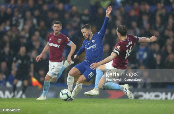 Chelsea's Eden Hazard and West Ham United's Mark Noble during the Premier League match between Chelsea FC and West Ham United at Stamford Bridge on...
