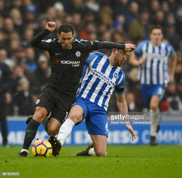Chelsea's Eden Hazard battles with Brighton Hove Albion's Dale Stephens during the Premier League match between Brighton and Hove Albion and Chelsea...
