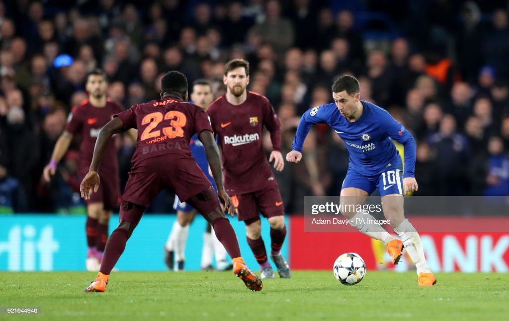 Chelsea's Eden Hazard (right) breaks through the Barcelona defence during the UEFA Champions League round of sixteen, first leg match at Stamford Bridge, London.