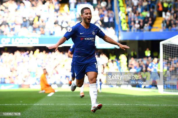 Chelsea's Eden Hazard celebrates scoring his side's first goal of the game with team mates during the Premier League match at Stamford Bridge London