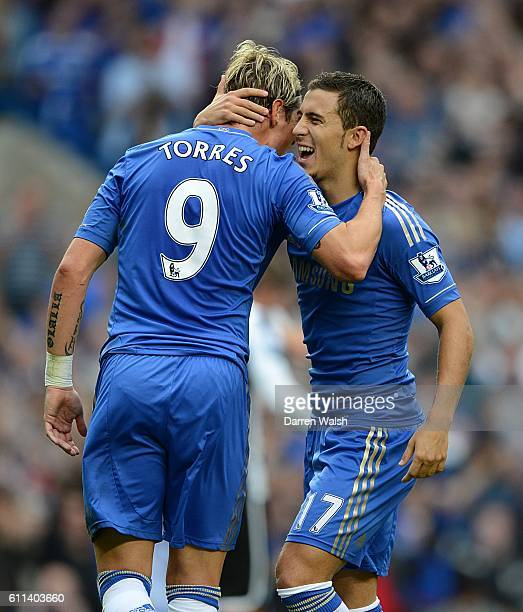 Chelsea's Eden Hazard celebrates scoring his side's first goal of the game from the penalty spot with teammate Fernando Torres