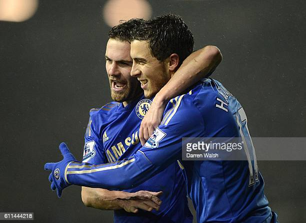 Chelsea's Eden Hazard celebrates with teammate Juan Mata after scoring his side's fourth goal of the game