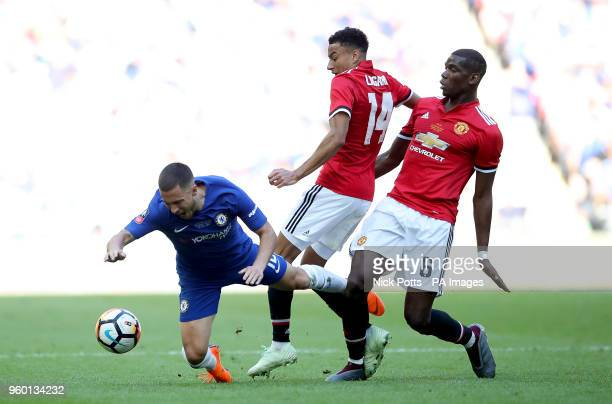 Chelsea's Eden Hazard goes down between Manchester United's Jesse Lingard and Manchester United's Paul Pogba during the Emirates FA Cup Final at...