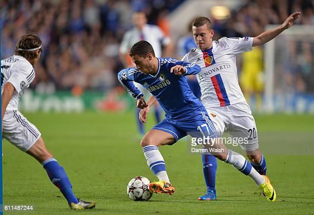 Chelsea's Eden Hazard in action with FC Basel's Fabian Frei