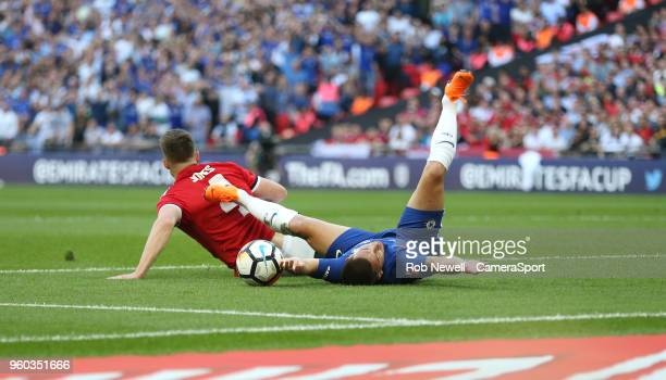 Chelsea's Eden Hazard is brought down in the penalty area by Manchester United's Phil Jones to earn his side a penalty during the Emirates FA Cup...
