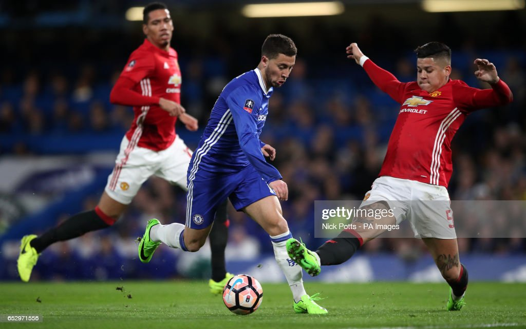 Chelsea's Eden Hazard is challenged by Manchester United's Marcos Rojo (right) during the Emirates FA Cup, Quarter Final match at Stamford Bridge, London.