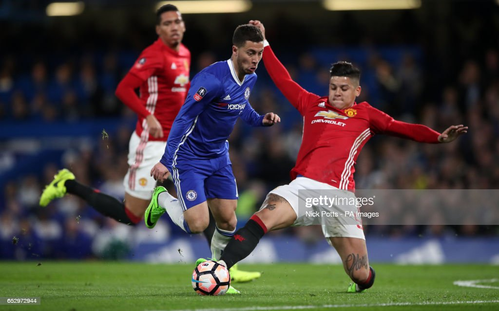 Chelsea's Eden Hazard is challenged by Manchester United's Marcos Rojo during the Emirates FA Cup, Quarter Final match at Stamford Bridge, London.