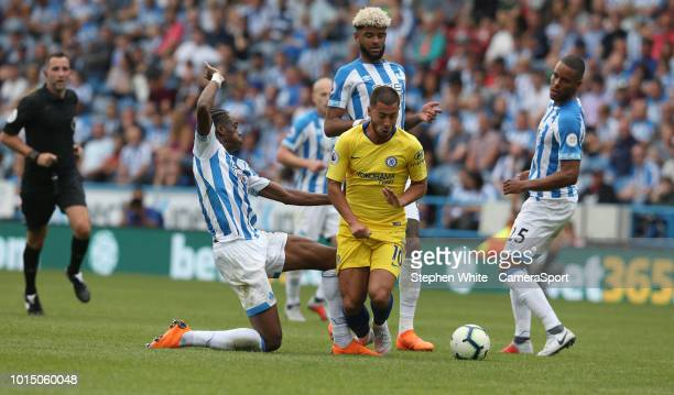 Chelsea's Eden Hazard is tackled by Huddersfield Town's Terence Kongolo during the Premier League match between Huddersfield Town and Chelsea FC at...