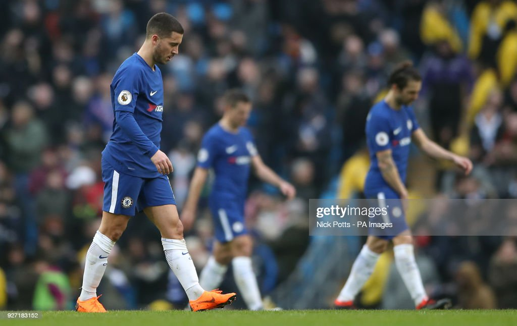 Chelsea's Eden Hazard (left) looking dejected during the Premier League match at the Etihad Stadium, Manchester.