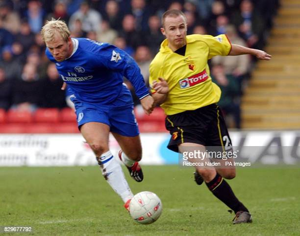 Chelsea's Eidur Gudjohnsen and Watford's Paul Devlin battle for the ball during the FA Cup Third Round match at Watford's Vicarage Road ground Final...