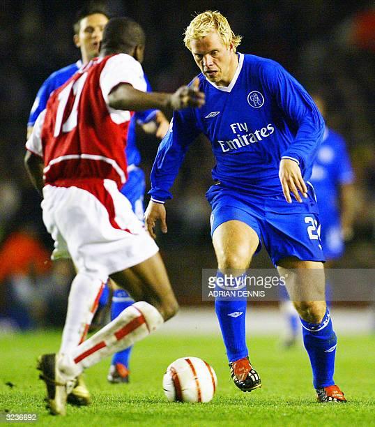 Chelsea's Eidur Gudjohnsen moves the ball against Arsenal's Lauren during their Champions League quarterfinal second leg football match against...