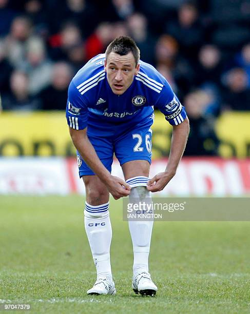 Chelsea's English captain John Terry adjusts his socks during the English Premier League football match between Wolverhampton Wanderers and Chelsea...
