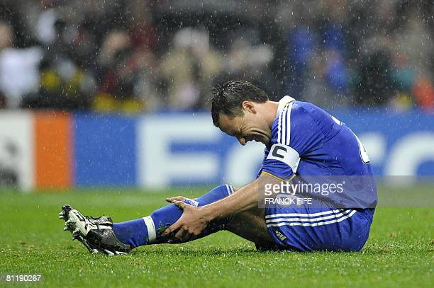 Chelsea's English defender and captain John Terry misses a penalty during a penalty shoot out in the final of the UEFA Champions League football...