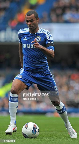 Chelsea's English defender Ashley Cole runs with the ball during the English Premier League football match between Chelsea and Stoke City at Stamford...