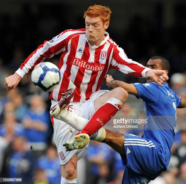 Chelsea's English defender Ashley Cole vies with Stoke City's English striker Dave Kitson during the English Premier League football match between...