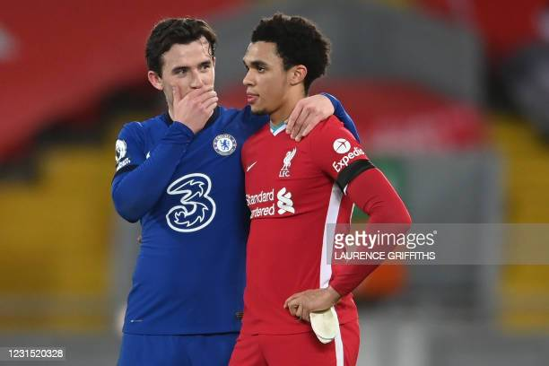 Chelsea's English defender Ben Chilwell and Liverpool's English defender Trent Alexander-Arnold react at the final whistle during the English Premier...
