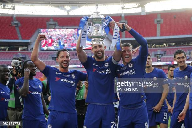 Chelsea's English defender captain Gary Cahill Chelsea's English midfielder Danny Drinkwater and Chelsea's English midfielder Ross Barkley hold up...