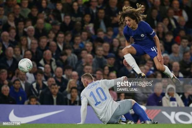Chelsea's English defender Ethan Ampadu jumps a tackle by Everton's English striker Wayne Rooney during the English League Cup fourth round football...