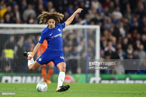 Chelsea's English defender Ethan Ampadu passes the ball during the English League Cup fourth round football match between Chelsea and Everton at...