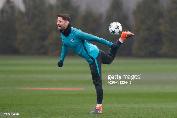 Chelsea's English defender Gary Cahill attends a training session at Chelsea's Cobham training facility in Stoke D'Abernon southwest of London on...