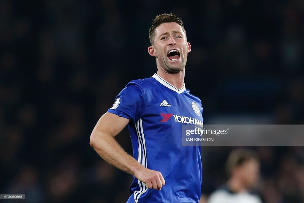 Chelsea's English defender Gary Cahill celebrates their 2-1 victory at the end of the English Premier League football match between Chelsea and Tottenham Hotspur at Stamford Bridge in London on November 26, 2016. / AFP / Ian KINGTON / RESTRICTED TO EDITORIAL USE. No use with unauthorized audio, video, data, fixture lists, club/league logos or 'live' services. Online in-match use limited to 75 images, no video emulation. No use in betting, games or single club/league/player publications. /