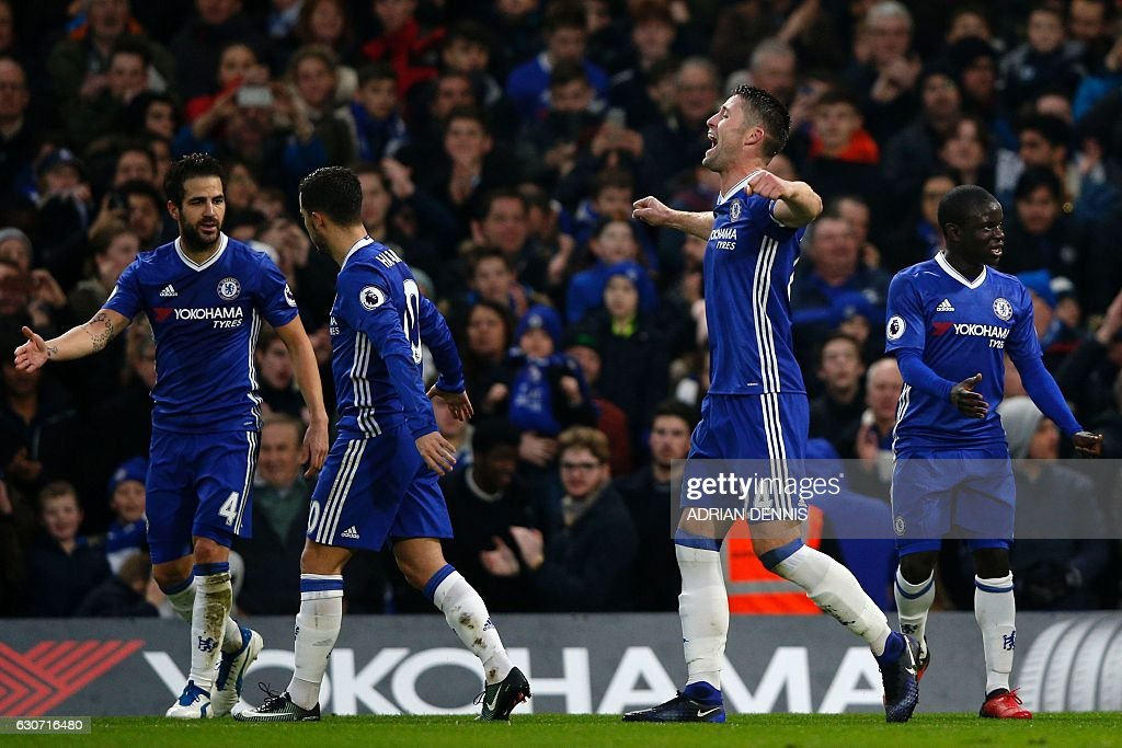 Chelsea's English defender Gary Cahill (2nd R) celebrates with teammates after scoring the opening goal of the English Premier League football match between Chelsea and Stoke City at Stamford Bridge in London on December 31, 2016. / AFP / Adrian DENNIS / RESTRICTED TO EDITORIAL USE. No use with unauthorized audio, video, data, fixture lists, club/league logos or 'live' services. Online in-match use limited to 75 images, no video emulation. No use in betting, games or single club/league/player publications. /