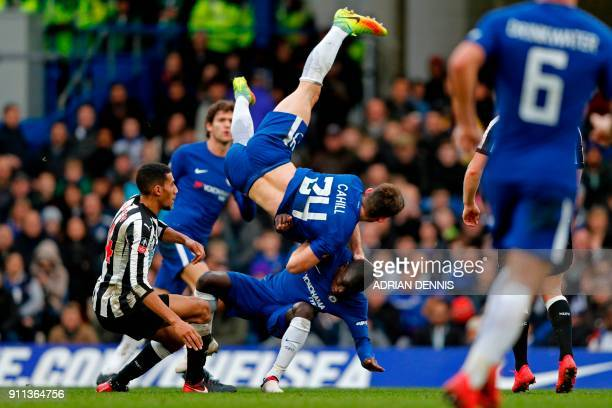 TOPSHOT Chelsea's English defender Gary Cahill collides with Chelsea's French midfielder N'Golo Kante after winning a header from Newcastle United's...