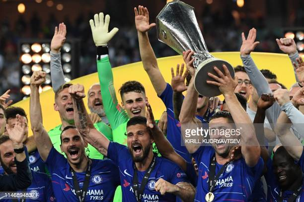 TOPSHOT Chelsea's English defender Gary Cahill holds the trophy as he celebrates with teammates after winning the UEFA Europa League final football...