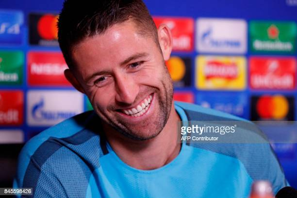 Chelsea's English defender Gary Cahill reacts during a press conference at Chelsea's Cobham training facility in Stoke D'Abernon southwest of London...